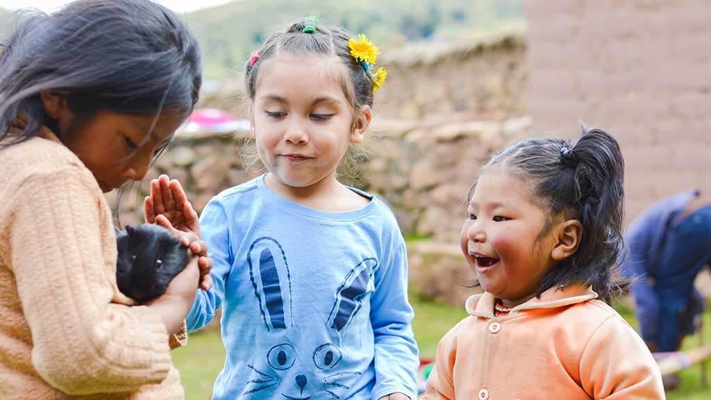 ecuadorian country kids with a guinea pig
