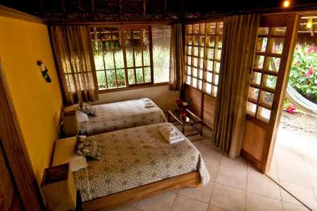 Huasquila Lodge Tena Ecuador - twin bedroom with hammock outside