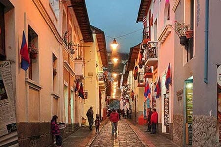 tourists wander la ronda streets in quito ecuador