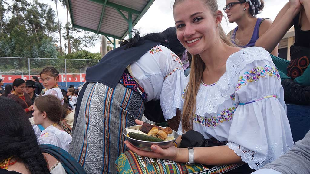 tourist enjoys traditional food at otavalo ecuador