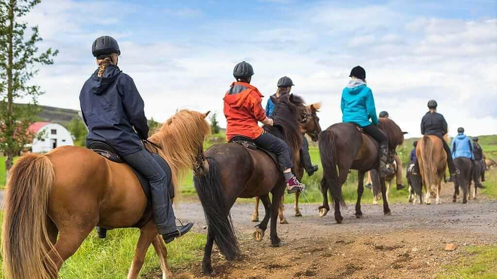 tourists enjoy pululahua horse riding tour ecuador
