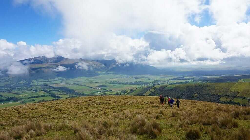 tourists treking pasochoa volcano ecuador