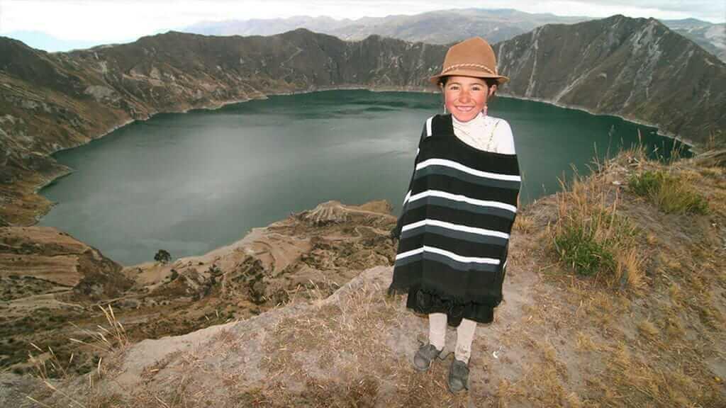 smiling indian girl at quilotoa lake ecuador