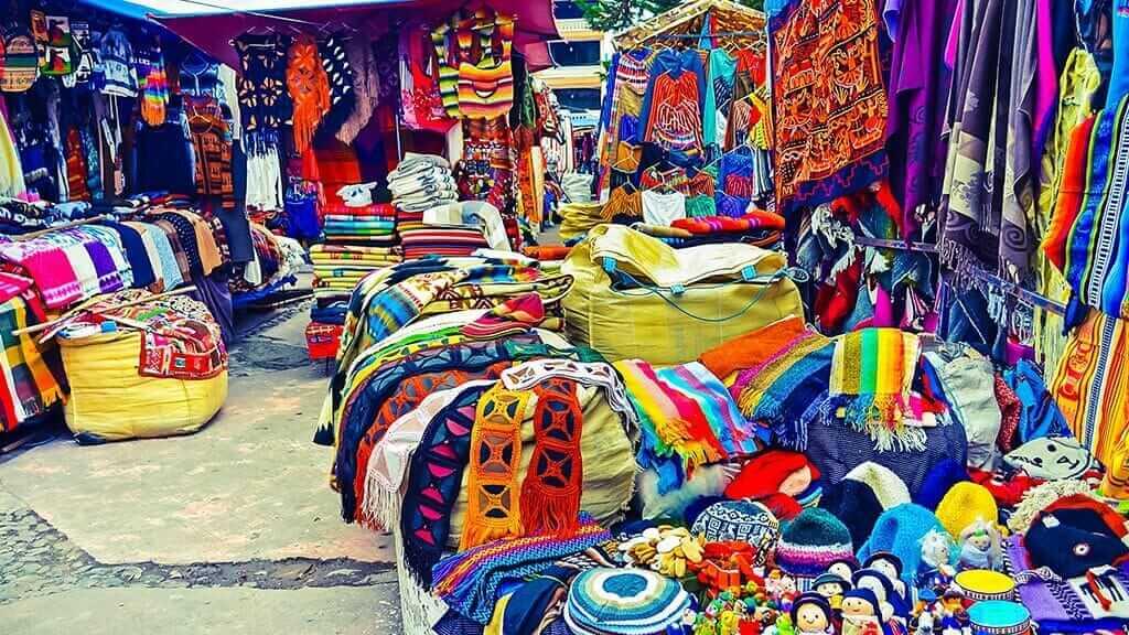 colorful market stalls at otavalo handicraft market ecuador