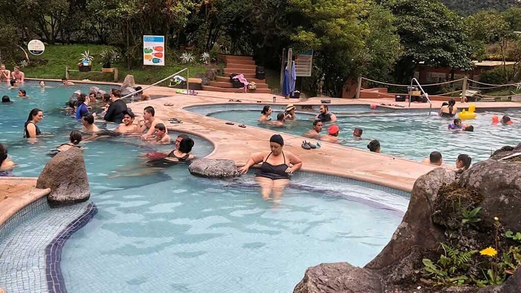 bathers at papallacta hot spring resort ecuador