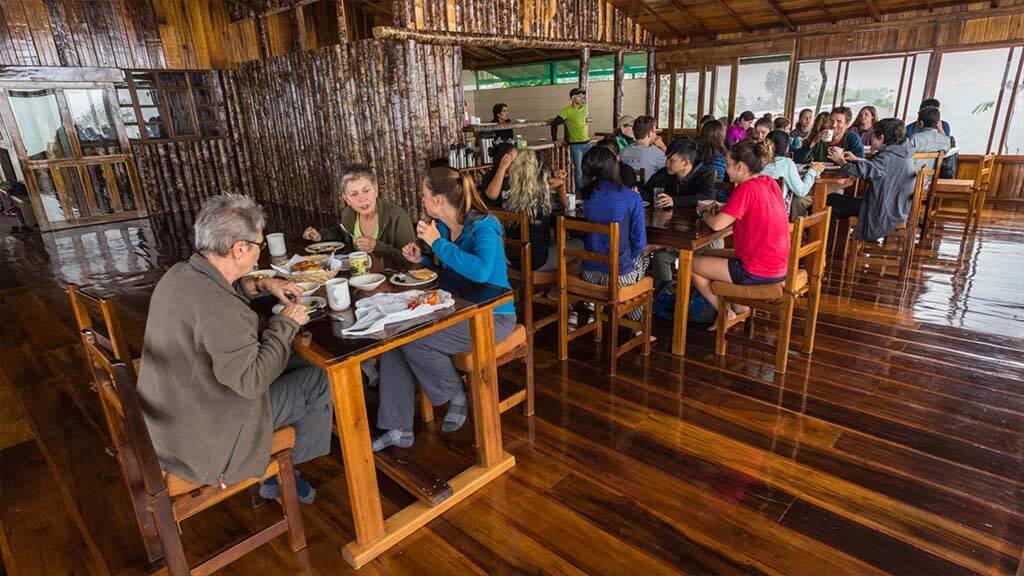tourists eating at santa lucia ecuador