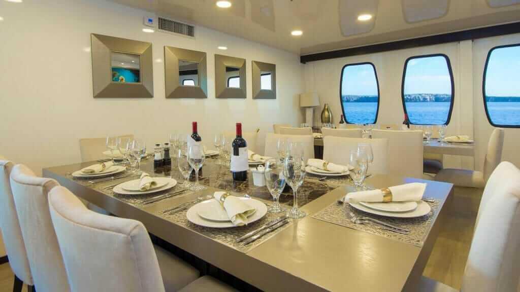 Alya catamaran Galapagos cruise - fine dining with ocean views
