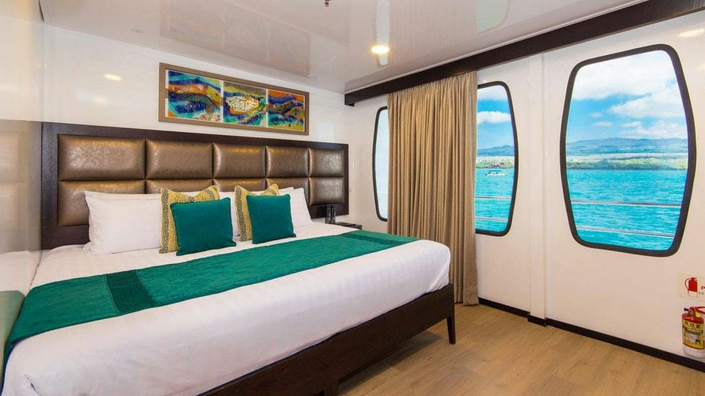 Alya catamaran Galapagos cruise - double guest cabin with large bed and two windows