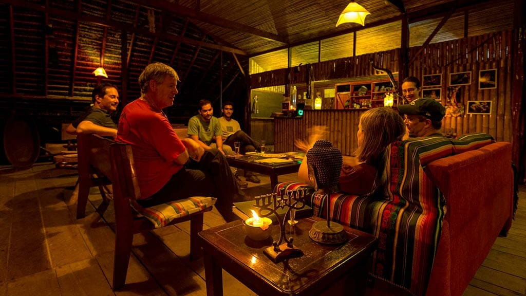 tourists share stories in the social area of anaconda lodge tena rainforest ecuador