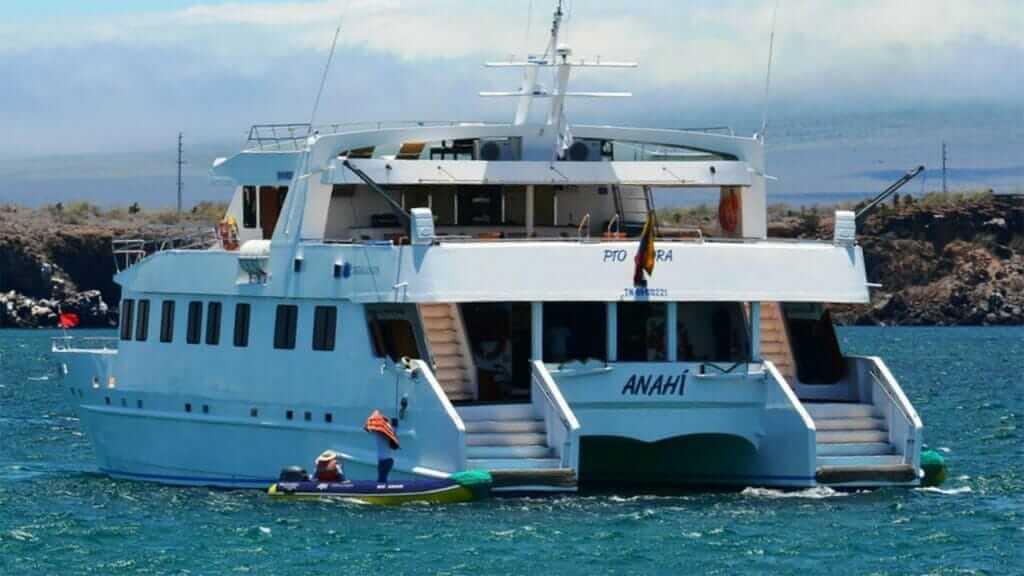 Anahi catamaran yacht Galapagos cruise - view of Anahi yacht and panga from behind