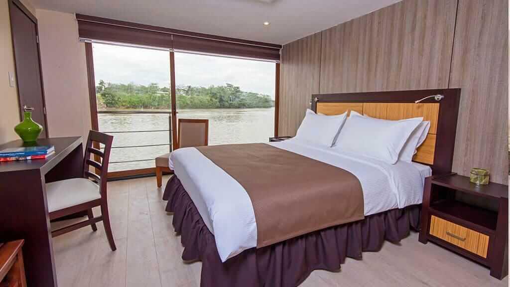 double bedroom with balcony on the anakonda amazon river cruise ecuador