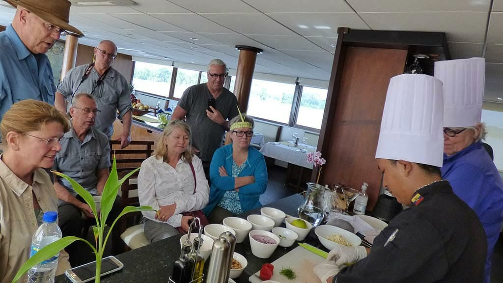 tourists enjoy a cooking class on the anakonda boat amazon river cruise ecuador