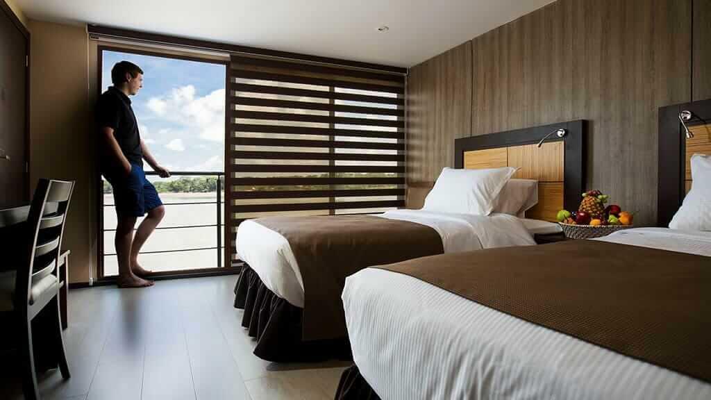 twin bedroom with balcony on the anakonda river cruise ecuador rainforest