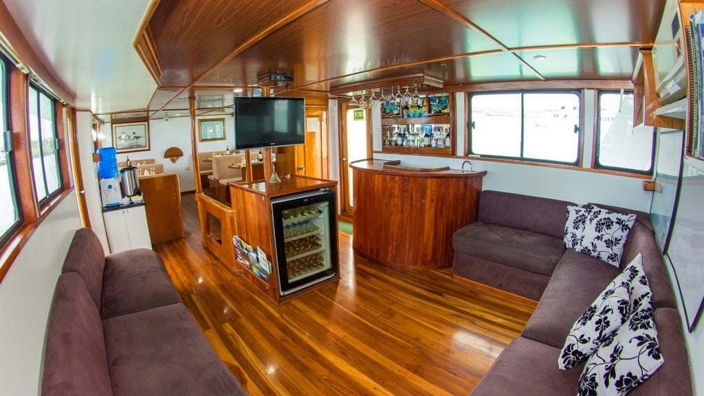 Aqua yacht Galapagos cruise - internal lounge area with tv and bar
