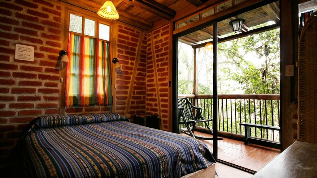 bellavista lodge ecuador double bedroom with balcony and cloud forest views