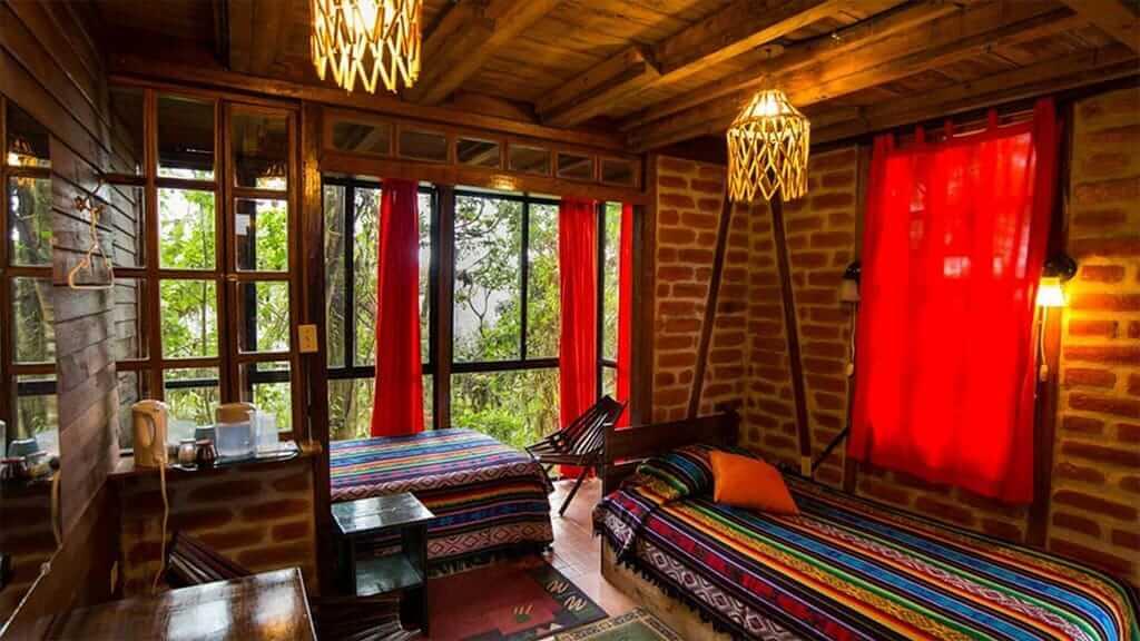 bellavista lodge ecuador twin bedroom with balcony and cloud forest views
