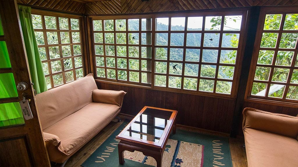 lounge area of suite room at bellavista cloud forest lodge ecuador