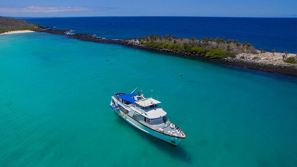 Beluga yacht Galapagos cruise - The Beluga from above anchored in turquoise waters