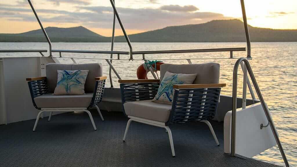 bonita yacht galapagos islands cruise - comfortable chairs to enjoy sunset views