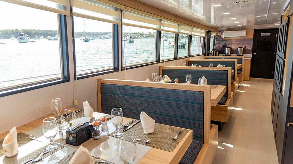 bonita yacht galapagos islands cruise - indoor dining tables