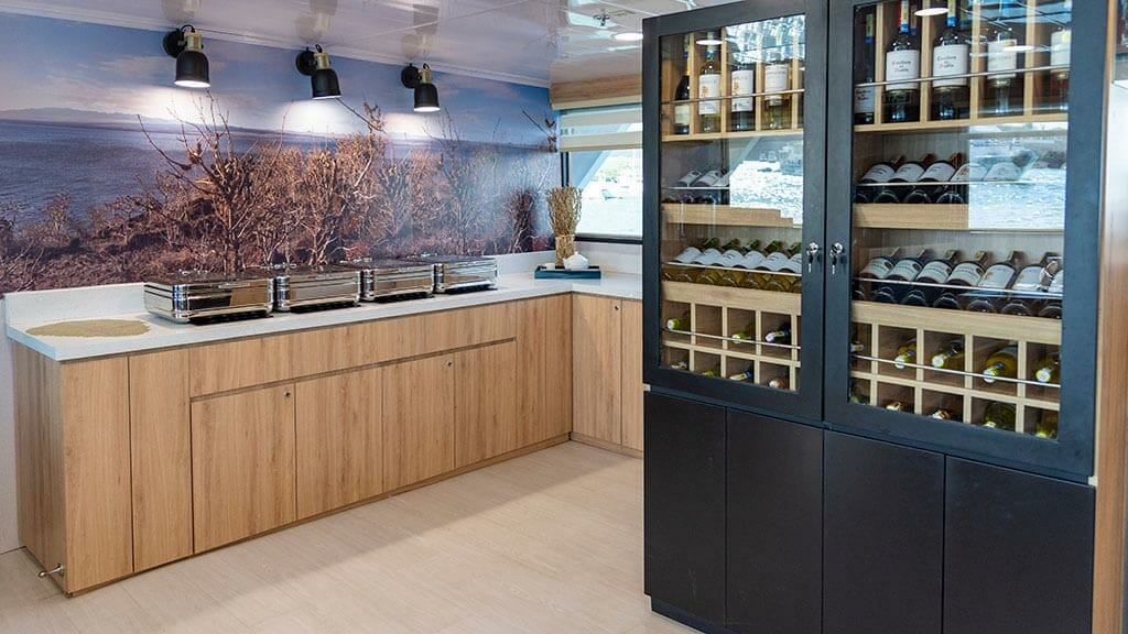 bonita yacht galapagos islands cruise - wine bar and breakfast buffet area