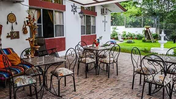 hotel el escalon guayaquil ecuador - outdoor patio with breakfast tables