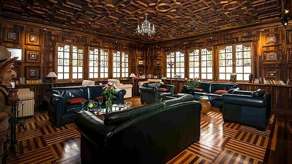 leather sofas and wooden floored lounge at boutique hotel manor quito