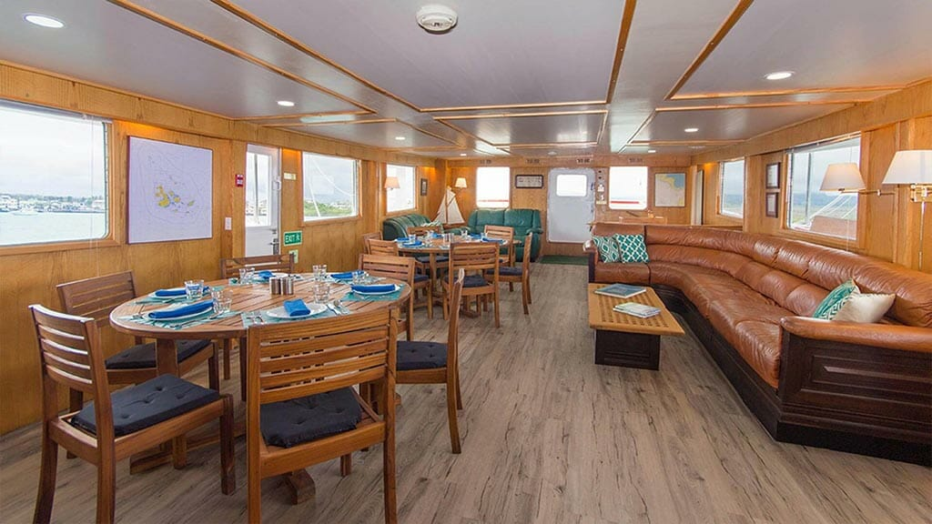 Cachalote Explorer yacht Galapagos cruise - indoor dining area and lounge