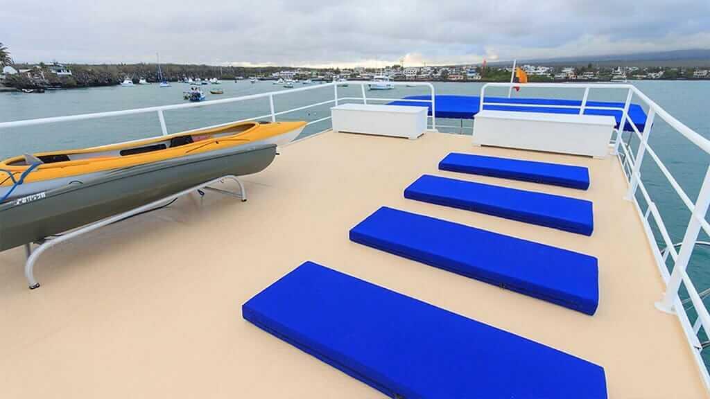 Cachalote Explorer yacht Galapagos cruise - panoramic sun deck with kayaks