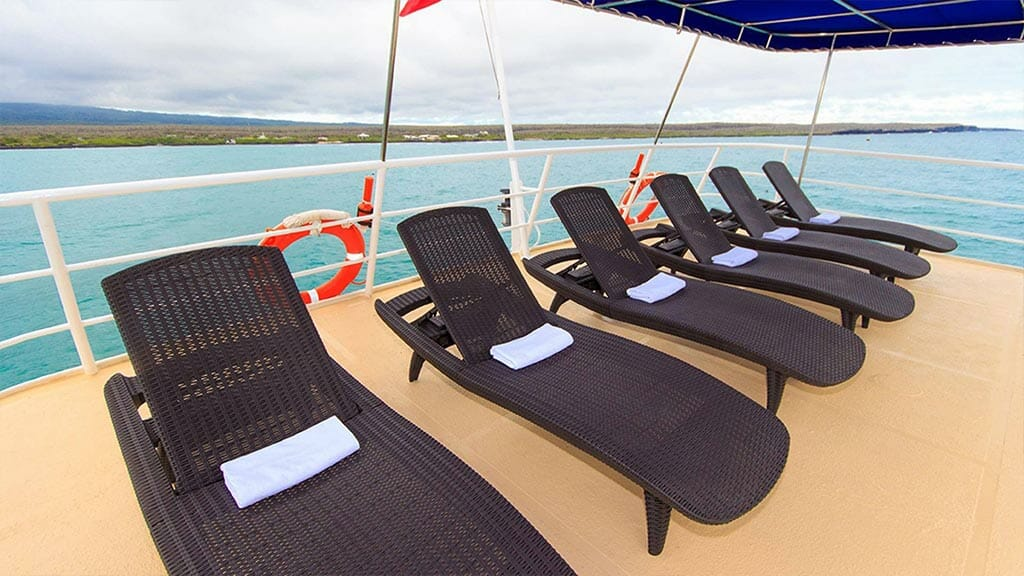 Cachalote Explorer yacht Galapagos cruise - panoramic sun deck with loungers