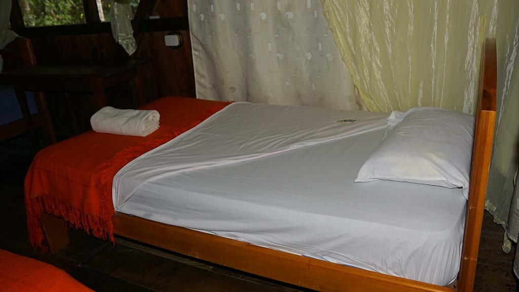 caiman lodge cuyabeno rainforest double bed guest cabin with mosquito net