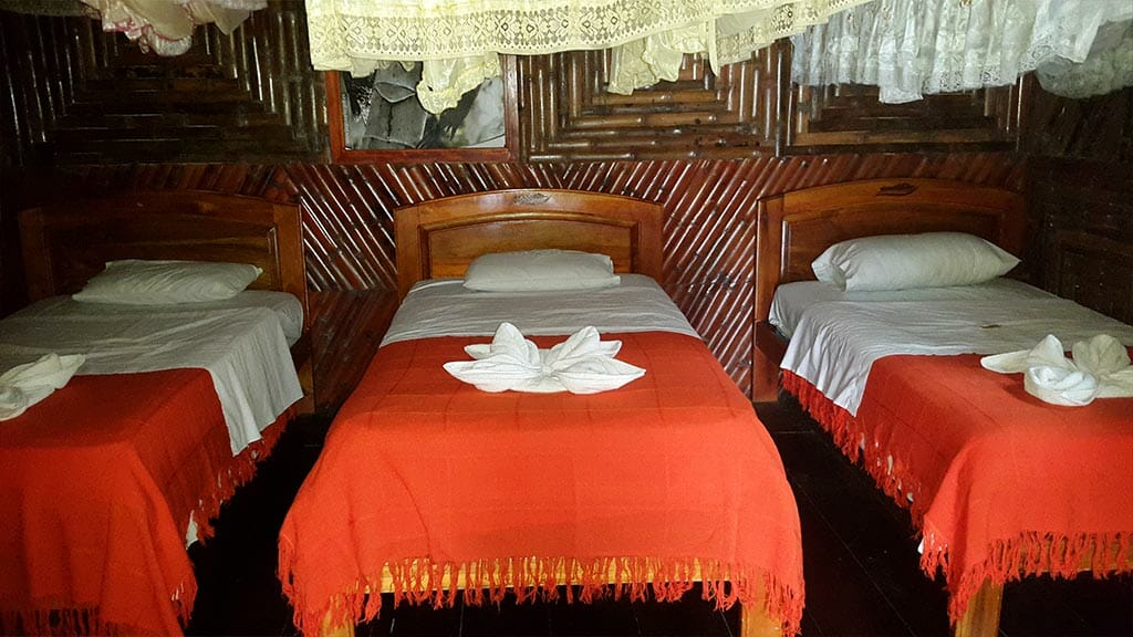 caiman lodge cuyabeno rainforest triple bed guest cabin with mosquito nets