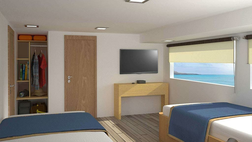 calipso yacht Galapagos islands cruise - twin cabin with large windows and wardrobe