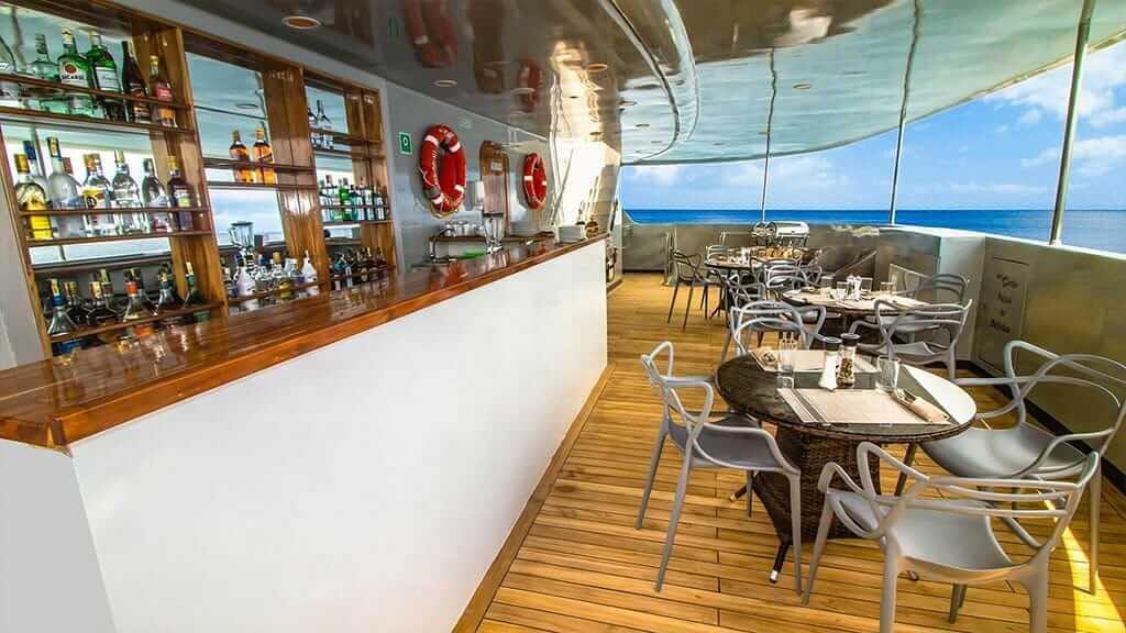 Camila yacht Galapagos cruise - al fresco dining and bar area