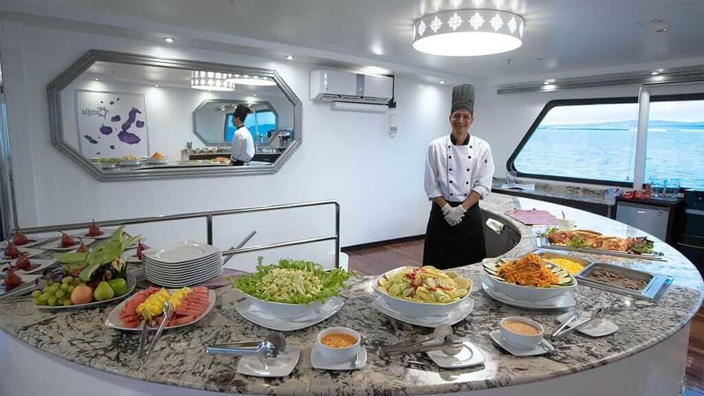 Camila yacht Galapagos cruise - chef serves buffet breakfast