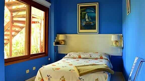 small single room painted blue at Hotel Casa Marita, Puerto Villamil, Isabela, Galapagos islands