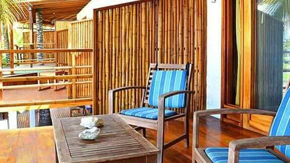 bamboo guest room balcony overlooking beach at Hotel Casa Marita, Puerto Villamil, Isabela, Galapagos islands