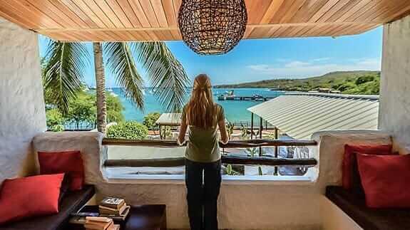 Hotel Casa Opuntia, baquerizo moreno, Galapagos – a tourist enjoys ocean views