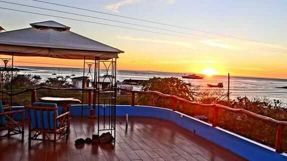 sunset ocean views from casa Playa Mann hotel terrace, baquerizo moreno, galapagos