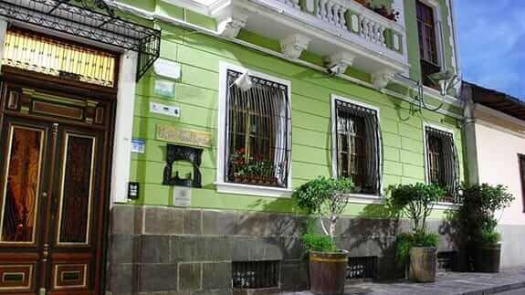 green facade of hotel casa san marcos quito