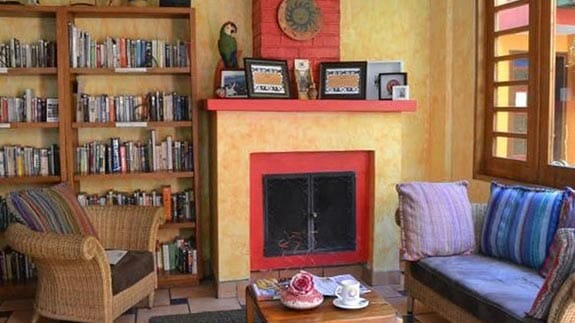 hotel casa sol quito social area with fire place and library