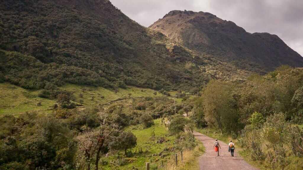 couple treking at cayambe coca ecological reserve in ecuador