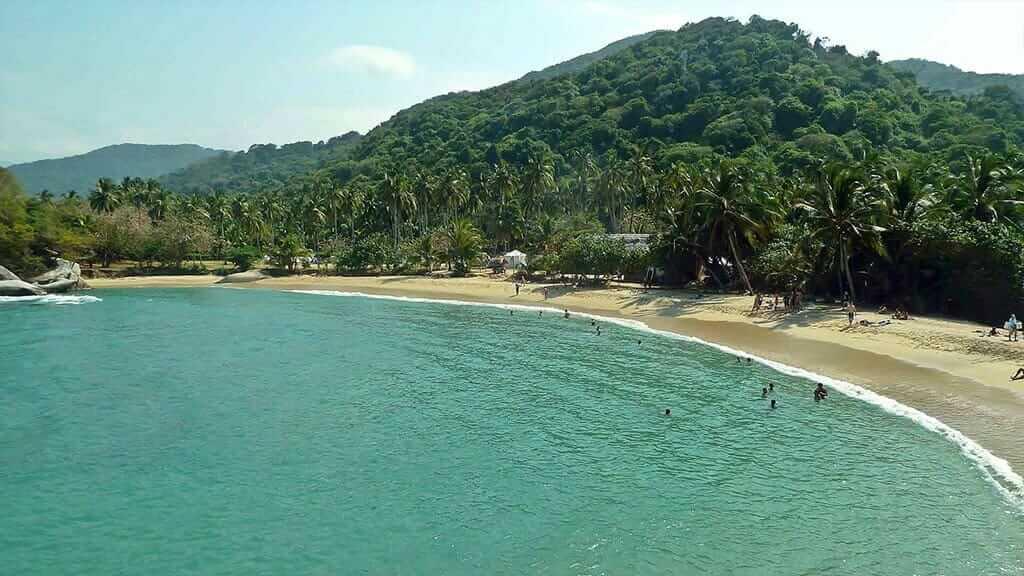 bathers enjoy tayrona beach Colombia