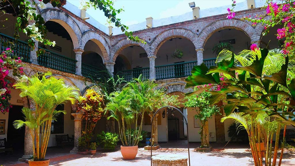 pretty colonial patio with flowers in colombia
