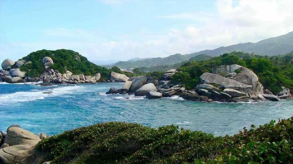 rocks, ocean and jungle at tayrona national park colombia