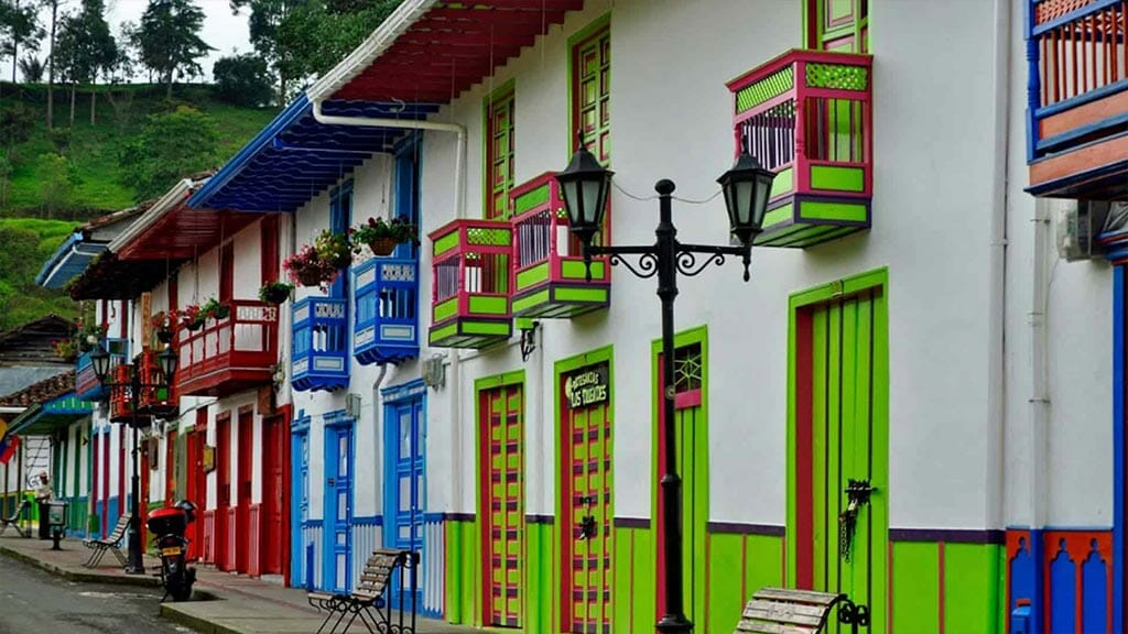 multi colored house facades and balconies in colombia coffee triangle