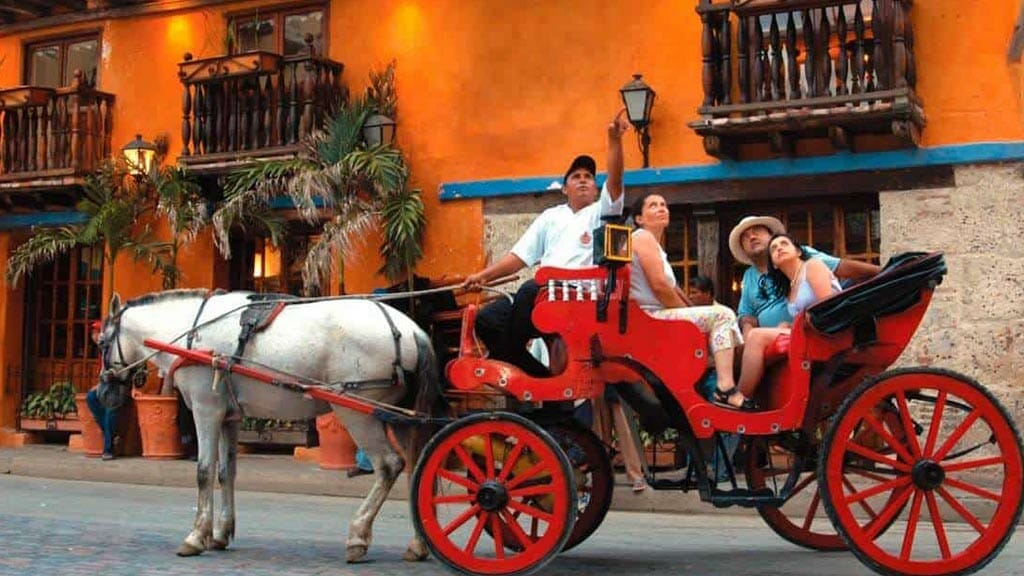 tourists enjoy a horse carriage ride in Cartagena colombia