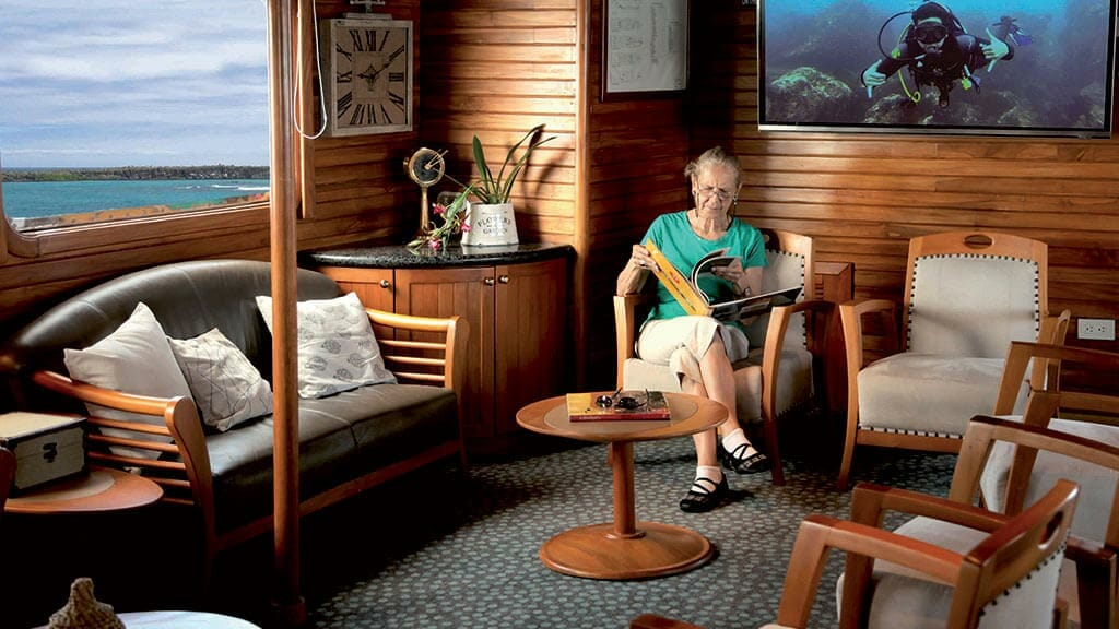 coral 1 and 2 yachts galapagos cruises - social lounge area for reading with ocean views