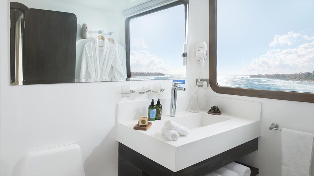 cormorant catamaran yacht galapagos island cruise - bathroom with ocean view