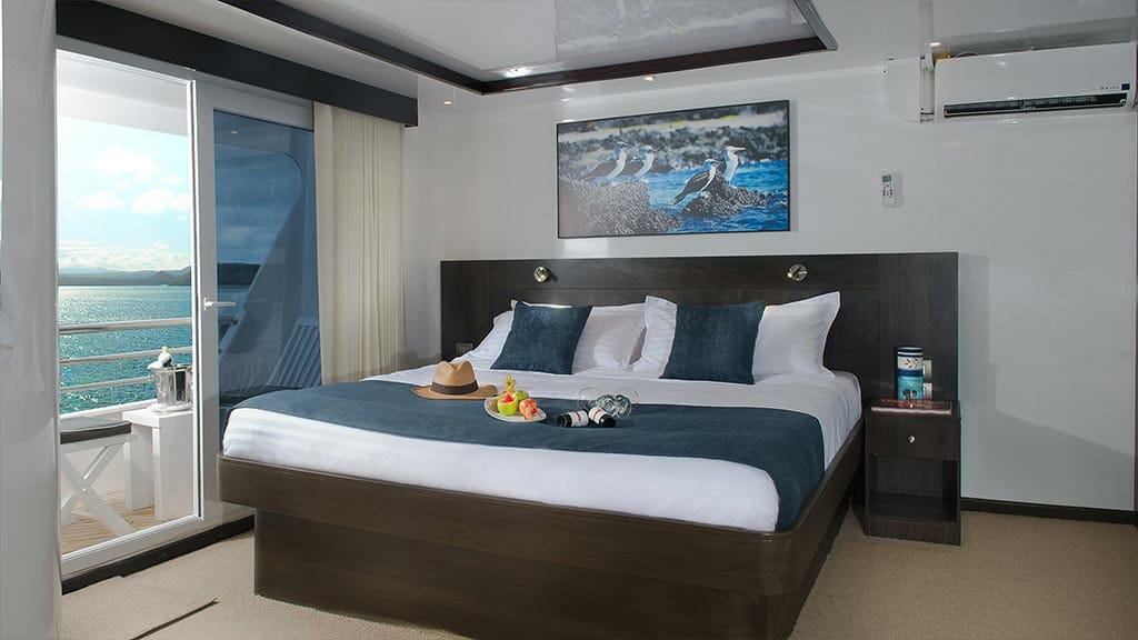 cormorant catamaran yacht galapagos island cruise - spacious double bed cabin with private balcony